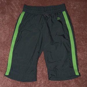 Nike small grey shorts with green stripe